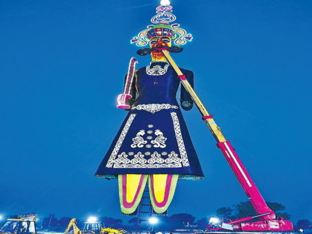 In nearly 12-hour effort, the country's largest 221 feet high Ravana, stood up on Thursday